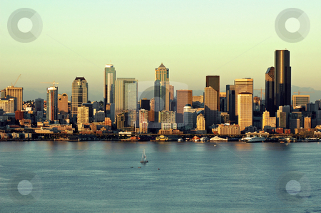 City Light stock photo, As the sun continues to lower in the horizon, the buildings of downtown Seattle, Washington are bathed in it's warm light. by Tim Thompson