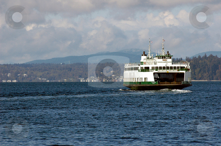 Puget Sound Ferry stock photo, A Washingto state ferry takes off on another run across the southern end of Puget sound. Several communities on the Washington Pennisula rely on the Washington state ferry system to get them where they need to be everyday. by Tim Thompson