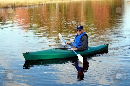 Senior Male, Kayaking stock photo, Senior male kayaking in the Fall by Tom and Beth Pulsipher