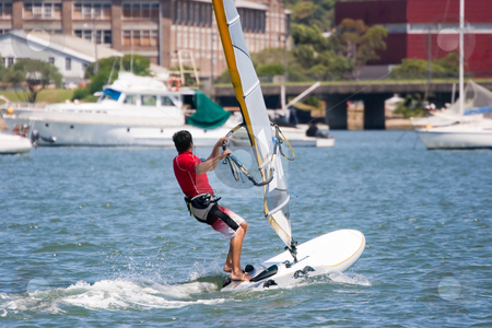 Sailboarder stock photo, Sailboarder on the water by Nicholas Rjabow