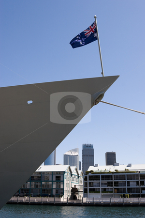 Warship Bow stock photo, Bow of a naval vessel with an Australian flag, with Sydney in the background by Nicholas Rjabow