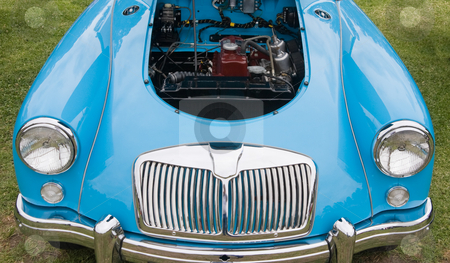 Blue Motor Vehicle stock photo, A blue colored motor vehicle showing the engine bay by Nicholas Rjabow
