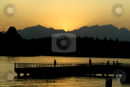 Brothers Mountains Sunset stock photo, July 30, 2003 :  As the sun went down over the Brothers Mountains a golden sunset lit up Dyes Inlet in front of Lions Park in Bremerton, Washington. by Jesse Beals