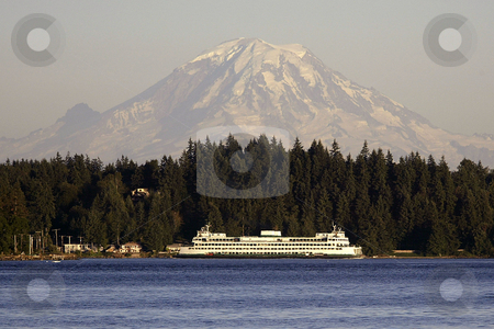 Mt. Rainier stock photo, July 17, 2003 : A Washington State Ferry could be seen passing through Sinclair Inlet with a snow topped  Mt. Rainier behind it.  The view from Illahee fishing pier on a sunny day can offer some breath taking pictures in Bremerton, Washington by Jesse Beals