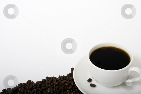 Coffee and Coffee Beans stock photo, A coffee cup on the right-hand side of a white background filled with coffee. Coffee beans placed on saucer and along bottom of the frame. by Steve Smith