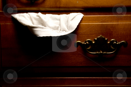 Panties stock photo, A pair of panties hanging out of a drawer. by Robert Byron