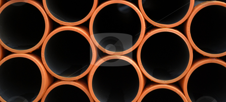 Orange and Black Background stock photo, Pipes with Orange tips as a background by Robert Cabrera