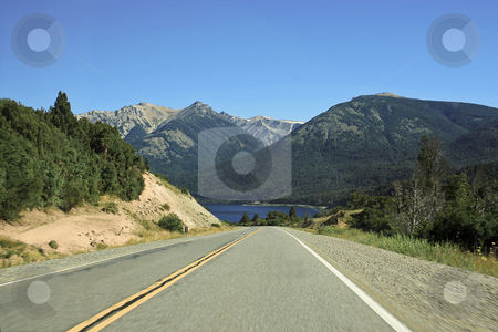 Right hand side of the road towards the lake stock photo, Driving down the road towards the turquonise colored lake in the summer of Patagonia by Rafael Franceschini