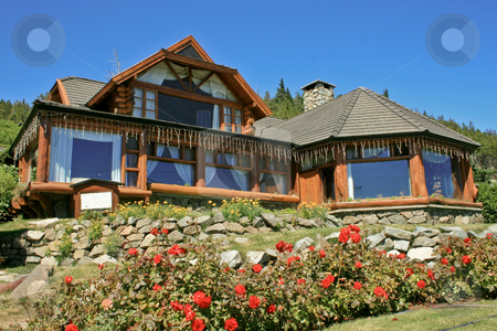 Beautiful wooden house stock photo, Living in a charming wooden house in Bariloche, Argentina. by Rafael Franceschini