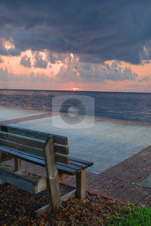 Stormy Daybreak stock photo, Bench with view of stormy daybreak over the ocean by Robert Cabrera