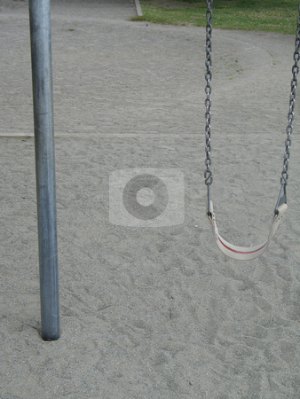 Swing in a playground stock photo, Swing in a playground by Mbudley Mbudley
