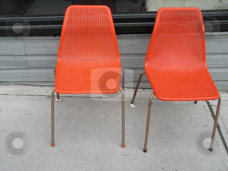 Orange chairs stock photo, Orange chairs by Mbudley Mbudley