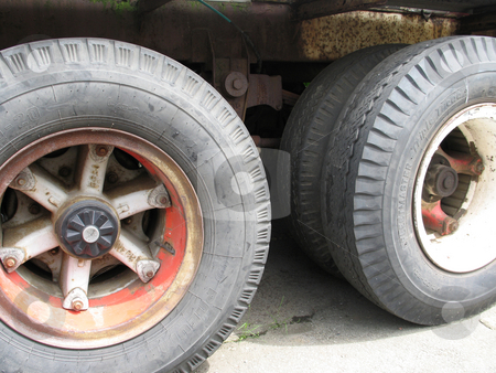 Large truck tires stock photo, Large truck tires by Mbudley Mbudley