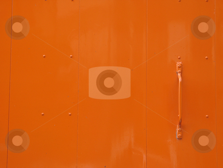 Slick orange metal door stock photo, Slick orange metal door by Mbudley Mbudley