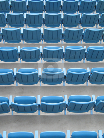 Blue aligned plastic chairs stock photo, Blue aligned plastic chairs by Mbudley Mbudley
