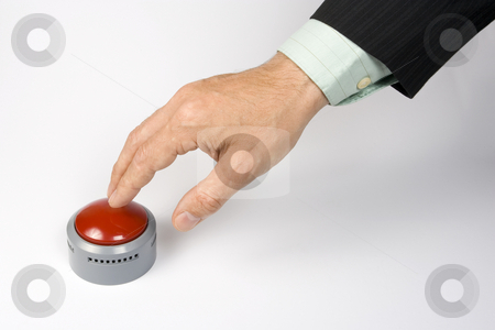 Panic button stock photo, A male hand actuating a panic button on a white surface. by Steve Smith