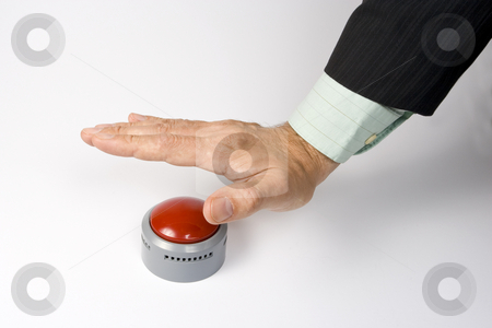 Pressing panic button stock photo, A male hand actuating a panic button on a white surface. by Steve Smith