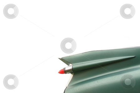 Cadillac Wing stock photo, Antique green caddy wings with red tail light isolated by Jack Schiffer