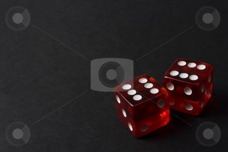 Two red dice on a dark background stock photo, Two Red Dice by Steve Smith