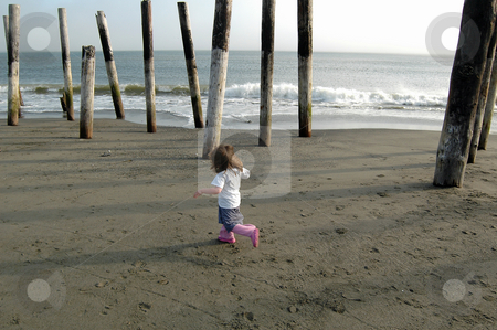 Beach Fun stock photo, This little girl was having a blast just running up and down the beach on a summer afternoon near Ocean Shores, Wa. by Tim Thompson