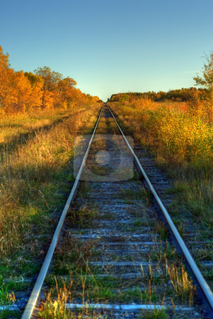 Railroad Tracks stock photo, A set of railroad tracks running across the country shot in HDR by Richard Nelson