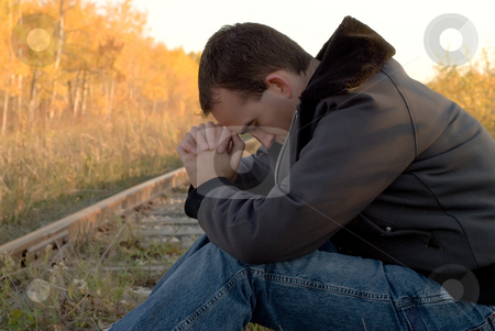Mood Disorder stock photo, A young man suffering from a mood disorder by Richard Nelson