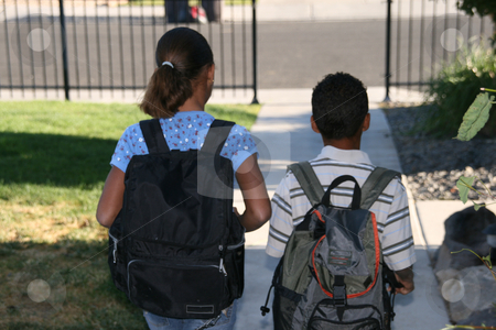 Off to School stock photo, Two african american mixed race children walking off to school by Robin Russell