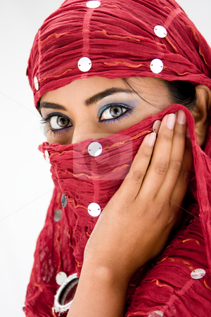 Woman with scarf stock photo, Beautiful woman with red head scarf, isolated by Paul Hakimata