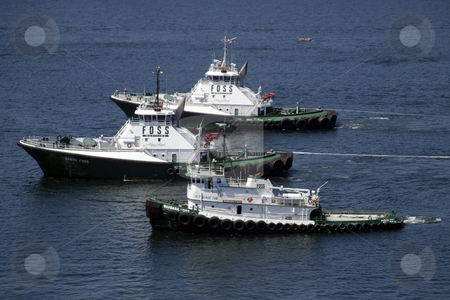 Tug Boats stock photo, July 21, 2003 : Construction was under way on the second Narrows bridge.  Tug boats were brought in to help transport the narrows bridge caisson were workers would start to build the base of the bridge in Tacoma, Washington by Jesse Beals