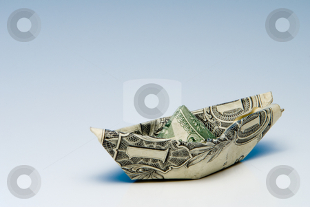 Floating Dollar stock photo, A paper boat made out of a dollar bill. by Robert Byron