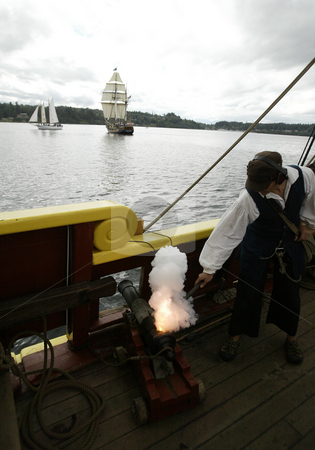 Tall Ship Cannon Battle stock photo, 27, August 2008:  Lady Washington gunner Roscoe Washcher fires a mock cannon at the Hawaiian Chieftain during Wednesday's battle sail in front of the Port of Brownsville in Brownsville, Washington.  For $50.00 you could ride on one of the two tall ships during the canon battle between the two boats. by Jesse Beals