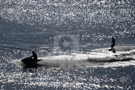 Jet Ski stock photo, July 20, 2008 : A jet skier pulls a skier along the shore line of Tracyton, Washington near the boat launch Sunday afternoon. by Jesse Beals