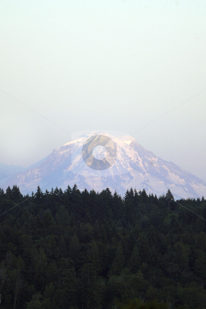 Mt. Rainer stock photo, July 22,2004 :  Mount Rainier could be seen poking out from the haze of clouds in Bremerton, Washington. The mountain still had snow on it's top even though it was the middle of summer. by Jesse Beals