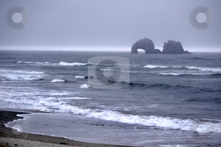 Rockaway, Oregon  stock photo, August 18, 2008 :  Ruff waves could be seen crashing on the beachs of Rockaway, Oregon during an afternoon rain storm.  The Oregon beaches are tourist attractions during the summer months. by Jesse Beals