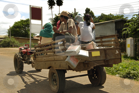 Poor people on a car stock photo, People sitting on a car traveling with rice and food by Ichi Photo