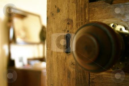 Behind the Door stock photo, A partially open door leading into a bedroom by Jeff Crowe