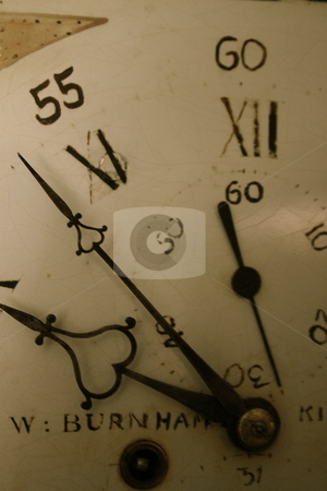 Grandfather clock face stock photo, An antique grandfather clock face by Jeff Crowe