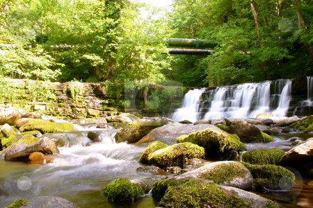 A country river and waterfall stock photo, A summer river and waterfall in County Durham, England by Jeff Crowe