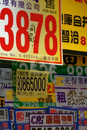 Crowded Wall of Signs stock photo, A wall in Hong Kong covered with signs by Jeff Crowe