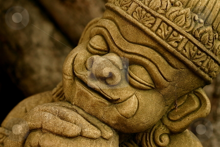 Statue stock photo, A stone statue of a little Buddha at a Thai temple by Jeff Crowe