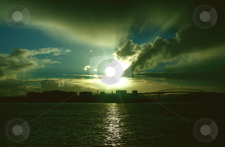 Sunset over Auckland stock photo, The setting sun in Auckland by Jeff Crowe