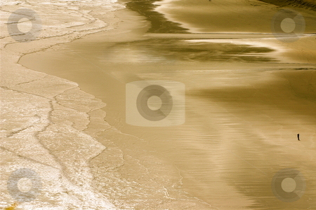 Lone Figure on Beach stock photo, Aerial shot of a single person stading on a large beach in New Zealand. by Jeff Crowe