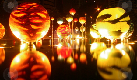 Reflections stock photo, Reflective balls hover over a pond in Singapore by Jeff Crowe
