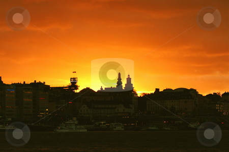 Sunset over Stockholm stock photo, Early winter sunset in Stockholm by Jeff Crowe