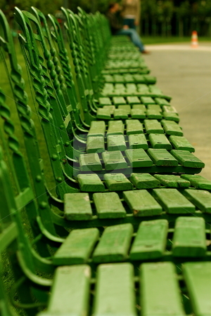 Row of Park Chairs stock photo, A row of wooden green chairs in a park in Vienna by Jeff Crowe