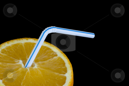 Orange drink stock photo, A ripe orange and a drinking straw by Stephen Gibson