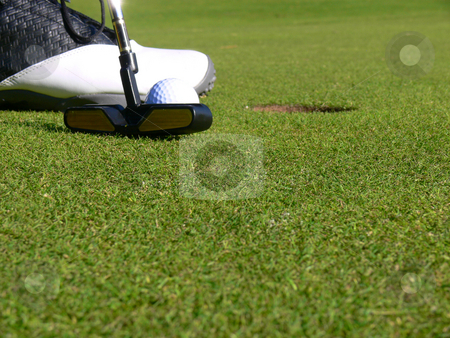 Golf - A short Putt stock photo, Close-up of a golfer concentrating to sink a short putt by Niklas Ramberg