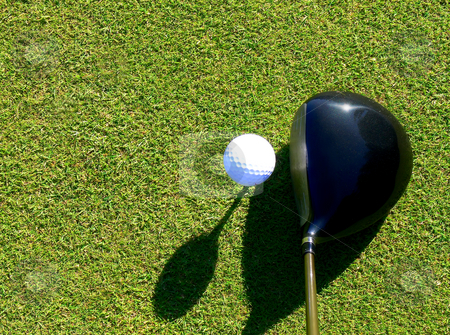 Golf - Driver and Ball stock photo, Close-up of ball and driver when preparing for a perfect drive by Niklas Ramberg