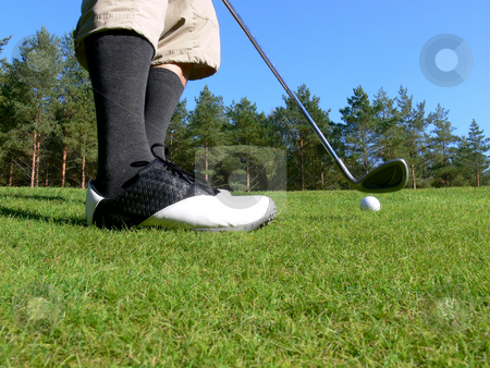 Golf - Pitching a Ball stock photo, Close-up of a golfer pitching a golf ball towards the green by Niklas Ramberg