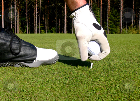 Golf - Teeing Up stock photo, A close-up of a golfer teeing up on 1st tee by Niklas Ramberg